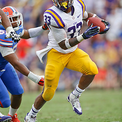 Oct 12, 2013; Baton Rouge, LA, USA; LSU Tigers running back Jeremy Hill (33) runs against the Florida Gators during the fourth quarter of a game at Tiger Stadium. LSU defeated Florida 17-6. Mandatory Credit: Derick E. Hingle-USA TODAY Sports