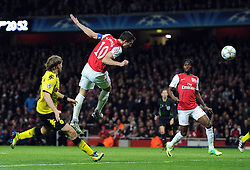 23.11.2011, Emirates Stadion, London, ENG, UEFA CL, Gruppe F, FC Arsenal (ENG) vs Borussia Dortmund (GER), im Bild Arsenal's Robin Van Persie heads the opening goal during the football match of UEFA Champions league, group F, between FC Arsenal (ENG) and Borussia Dortmund (POR) at Emirates Stadium, London, United Kingdom on 2011/11/23. EXPA Pictures © 2011, PhotoCredit: EXPA/ Sportida/ Chris Brunskill..***** ATTENTION - OUT OF ENG, GBR, UK *****