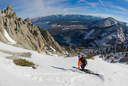 Andy Anderson descending Jakes Peak with Emerald Bay, Lake Tahoe and Cascade lake in the background