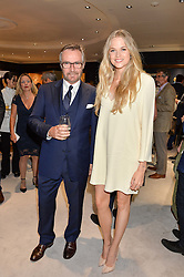 BRIAN DUFFY CEO of Mappin & Webb and GABRIELLA WILDE at a party to celebrate the opening of Mappin & Webb's Flagship Regent Street Boutique at 132 Regent Street, London on 28th June 2016.