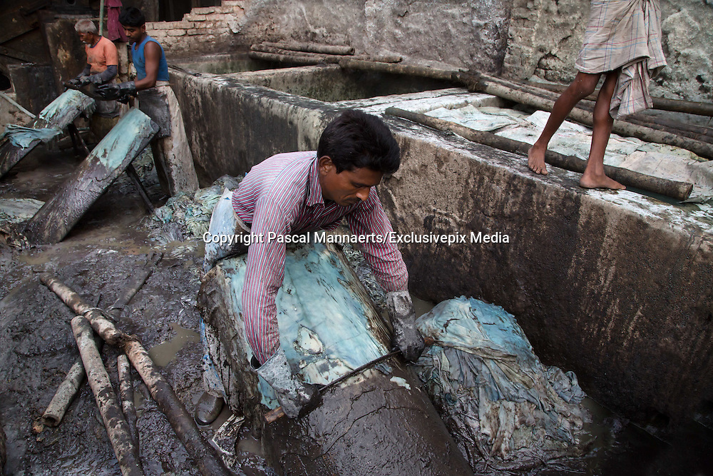 Slaves of Hazaribagh<br /> <br /> Hazaribagh is an area of Dhaka city, the capital of Bangladesh, and is known for its tannery industry and large leather processing zone. Up to 95% of the registered tanneries in Bangladesh are located in and around Hazaribagh. Currently, more than 2000 tanneries operate here, employing between 8.000 and 15.000 people. <br /> In 2013, the Zurich-based Green Cross Switzerland and the New York-based Blacksmith Institute published a report on the most polluted places in the world. The report &ldquo;The Top Ten Toxic Threats, Clean Up, Progress and Ongoing Challenges&rdquo;, puts Hazaribagh at number five. Most of the 185.000 people living in this area work in the factories and tanneries. They are forced to live in highly polluted environments.  A lot of children and teenagers also work in the factories.<br /> <br /> Photo Shows: Government officials told Human Rights Watch that they do not enforce environmental or labor laws with respect to Hazaribagh&rsquo;s tanneries, an estimated 90 percent of the tanneries in Bangladesh. The Hazaribagh tanneries employ up to 15,000 workers. (Human Rights Watch report, &ldquo;Toxic Tanneries: The Health Repercussions of Bangladesh&rsquo;s Hazaribagh Leather&rdquo;, October 2012).<br /> &copy;Pascal Mannaerts/Exclusivepix Media