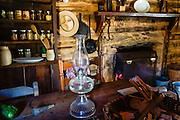 Restored 1890s cabin interior. Humpback Rocks Mountain Farm is a restored 1890s farmstead open to the public at Milepost 5.8 on the Blue Ridge Parkway, in Virginia, in the Blue Ridge Mountains (a subset of the Appalachian Mountains), USA. In summer, costumed interpreters demonstrate 1890s southern Appalachian mountain life. European settlers of the Appalachian Mountains forged a living from abundant native materials: hickory, chestnut, and oak trees provided nuts for food, logs for building, and tannin for curing hides; and the rocks were used as foundations, chimneys and stone fences. This farm was originally a Land Grant tract dispensed by the Commonwealth of Virginia to induce pioneers to settle; and later it became known as the William J. Carter Farm. The scenic 469-mile Blue Ridge Parkway was built 1935-1987 to aesthetically connect Shenandoah National Park (in Virginia) with Great Smoky Mountains National Park in North Carolina, following crestlines and the Appalachian Trail.