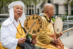 London, UK. 3 May, 2019. Buddhist Reverend Sister Yoshie Maruta and Reverend Gyoro Nagase of the Battersea Peace Pagoda join campaigners from Campaign For Nuclear Disarmament (CND), Stop the War Coalition, the Peace Pledge Union, the Quakers and other faith groups protesting outside Westminster Abbey against the holding of a National Service of Thanksgiving to mark fifty years of the Continuous at Sea Deterrent (CASD) attended by dignitaries including the Duke of Cambridge and the newly appointed Defence Secretary Penny Mordaunt.