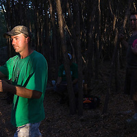 Bobby Baird, foreground, lines up a throw as Nick Cookman, background from left, Anthouny Aguirre and Clint Reefschneider watch during a disc golf mini-tournament Wednesday at Comanche Trail Park. Baird said their group of players is usually out at the course about three times a week.