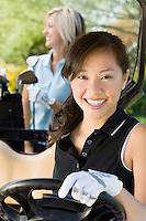 Golfer Sitting in Golf Cart