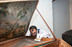 Conservator Jonathan Santa Maria Bouquet works on an ornate18th century harpsicord as part of the newly-refurbished St Cecilia's Hall, which has just undergone a 2 year, £6.5 million refurbishment which will see more of the University of Edinburgh's musical instrument collection on display to the public.<br />