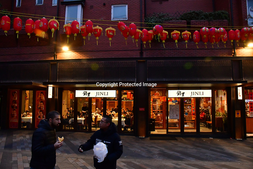 Hundreds of people watching Lion dance and browsing and buying Chinese New Year  souvignier gifts of the New Year of the Rat, in London Chinatown on 25th January 2020, London, UK