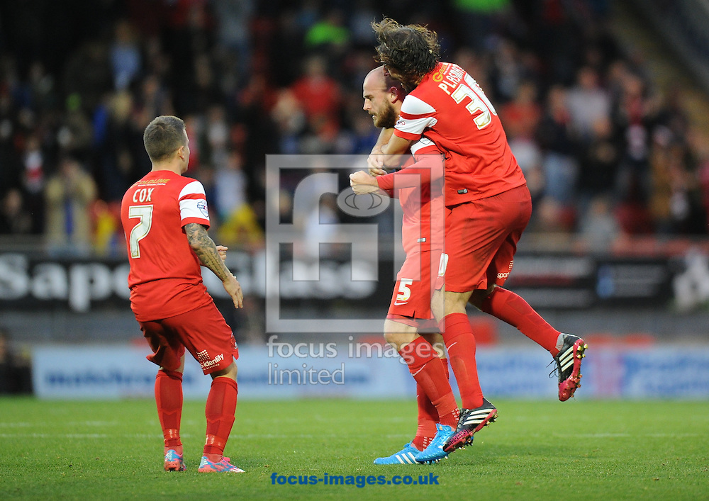 Scott Cuthbert of Leyton Orient (5) celebrates scoring the equaliser with Gianvito Plasmati (30) and Dean Cox (7) to make it 1-1 during the Sky Bet League 1 match at the Matchroom Stadium, London<br /> Picture by Alan Stanford/Focus Images Ltd +44 7915 056117<br /> 01/11/2014