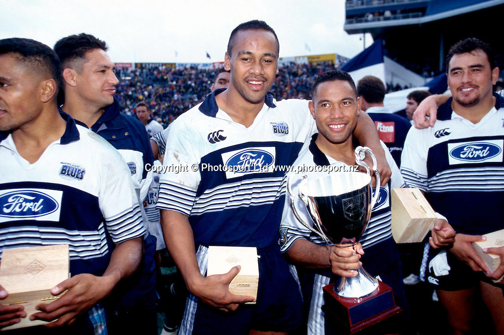 Jonah Lomu and Ofisa Tonu'u celebrate winning the final.<br /> Super 12 Rugby final between the Auckland Blues and Natal Sharks at Eden Park, Auckland, New Zealand on 25 May 1996.<br /> The Blues won the final 45-21.<br /> Copyright photo:  www.photosport.nz