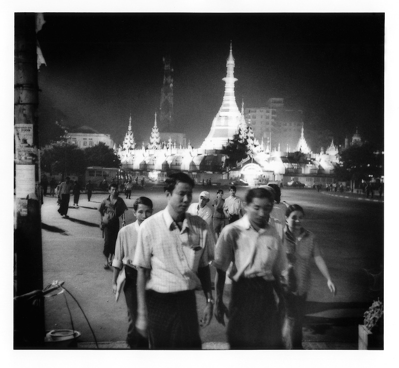 Evening rush hour in central Rangoon (Yangon) under the illuminated Sule Paya Pagoda, Burma (Myanmar).