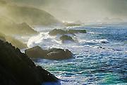 Cliffs and surf at sunrise, Garappatta State Beach, California