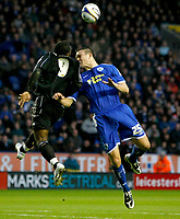 Photo: Steve Bond/Richard Lane Photography. Leicester City v Peterborough United. Coca-Cola Football League One. 20/12/2008. Jack Hobbs (R) Aaron McLean (L) clash in the air