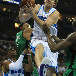 11 February 2009:  New Orleans Hornets forward Sean Marks (4) grabs a rebound over Boston Celtics guard Rajon Rondo (9) during a NBA game between the Boston Celtics and the New Orleans Hornets at the New Orleans Arena in New Orleans, LA.
