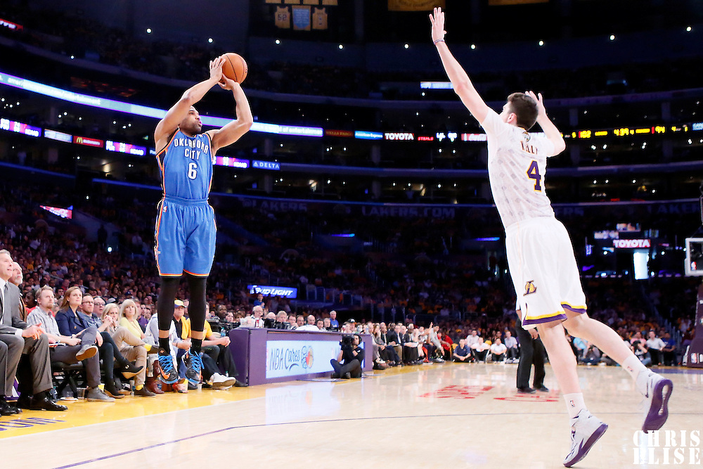 09 March 2014: Oklahoma City Thunder point guard Derek Fisher (6) takes a three point jumpshot over Los Angeles Lakers power forward Ryan Kelly (4) during the Los Angeles Lakers 114-110 victory over the Oklahoma City Thunder at the Staples Center, Los Angeles, California, USA.