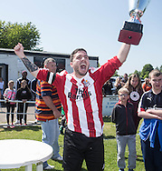 Dundee Argyle captain Kevin Egan lifts the Association Cup after Argyle beat Fintry Athletic in the Final at Fairfield Park<br /> <br />  - &copy; David Young - www.davidyoungphoto.co.uk - email: davidyoungphoto@gmail.com