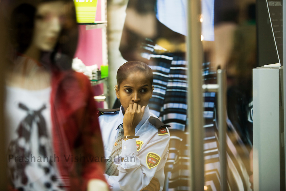 A security personell looks on at an outlet inside the Inorbit Mall Malad, in Mumbai, on Sunday Dec. 28, 2008.  Photographer:Prashanth Vishwanathan