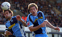 Photo: Frances Leader.<br />Wycombe Wanderers v Chester City. Coca Cola League 2.<br />01/10/2005.<br /><br />Wycombe's Roger Johnson (captain) and Mike Williamson head the ball.