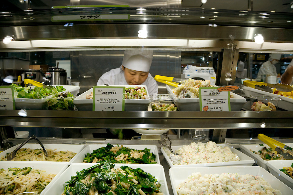counter with prepared food in an eatery in Tokyo