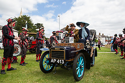 Datchet, UK. 30 June, 2019. Datchet Border Morris welcome a 1904 Humberette as it completes the 48-mile Ellis Journey for pre-1905 vehicles from Micheldever station near Winchester to Datchet. The Ellis Journey is a reenactment of the first recorded journey by a motorised carriage in England undertaken by pioneer automobilist Hon. Evelyn Ellis in his new, custom-built Panhard-Levassor on 5th July 1895.