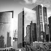 Chicago Loop black and whit picture with downtown city office buildings including the Nuveen curved glass green building. Photo Copyright © 2012 Paul Velgos with All Rights Reserved.