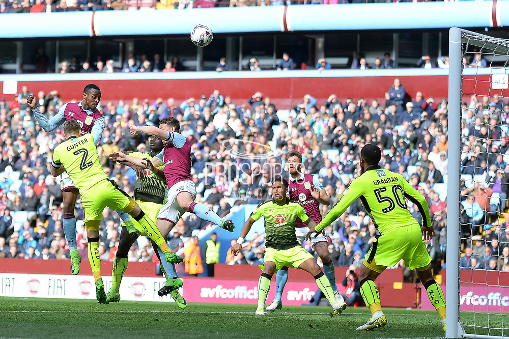 Aston Villa defender Alan Hutton (21) heads at goal during the EFL Sky Bet Championship match between Aston Villa and Reading at Villa Park, Birmingham, England on 15 April 2017. Photo by Dennis Goodwin.