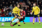 Ryan Fraser (24) of AFC Bournemouth is fouled by Matteo Guendouzi (29) of Arsenal during the The FA Cup match between Bournemouth and Arsenal at the Vitality Stadium, Bournemouth, England on 27 January 2020.