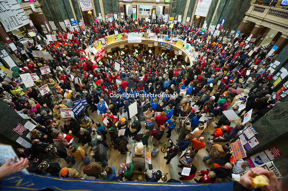 Protesters occupy the state Capitol in Madison, Wisconsin on February 24, 2011. The state budget proposed by Republican Gov. Scott Walker includes cuts in benefits for state workers and takes away many of their collective bargaining rights.     UPI/Brian Kersey