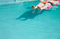 Person floating in pool