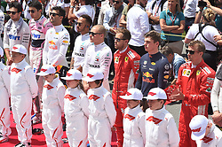 """Formula 1 drivers line up behind """"grid kids"""" prior to the start of the Canadian Grand Prix Sunday, June 10, 2018 in Montreal, Canada. Photo by Paul Chiasson/Canadian Press/ABACAPRESS.COM"""