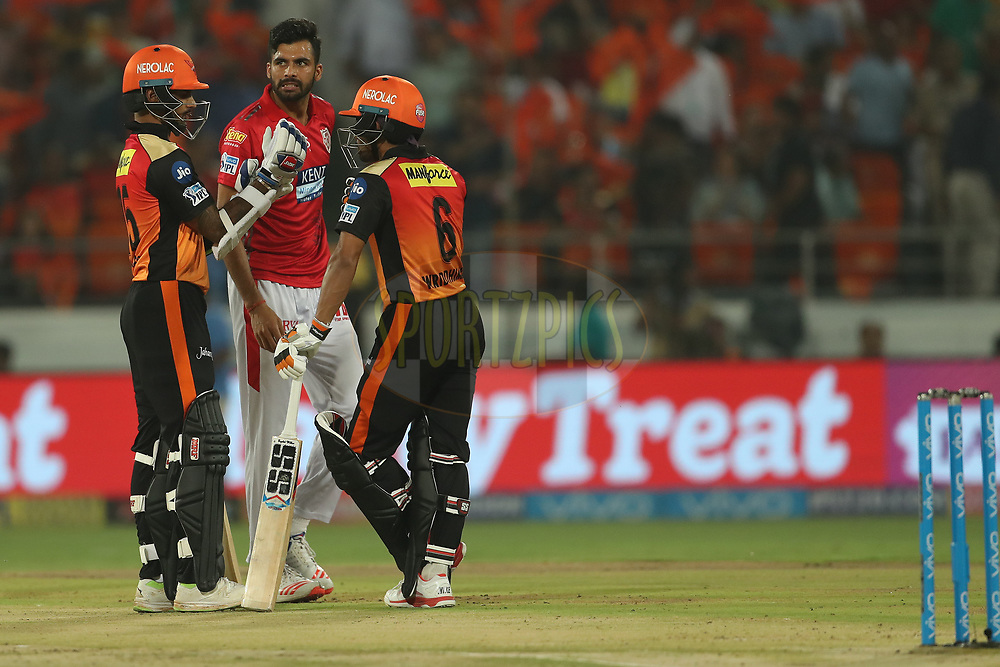Barinder Singh Sran of the Kings XI Punjab looks on as Wriddhiman  Saha of the Sunrisers Hyderabad and Shikhar Dhawan of the Sunrisers Hyderabad chat during match twenty five of the Vivo Indian Premier League 2018 (IPL 2018) between the Sunrisers Hyderabad and the Kings XI Punjab  held at the Rajiv Gandhi International Cricket Stadium in Hyderabad on the 26th April 2018.<br /> <br /> Photo by: Ron Gaunt /SPORTZPICS for BCCI