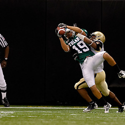 October 9, 2010; New Orleans, LA, USA;  Tulane Green Wave wide receiver Casey Robottom (19) catches a touchdown over Army Black Knights cornerback Antuan Aaron (3) during the fourth quarter at the Louisiana Superdome. Army defeated Tulane 41-23.  Mandatory Credit: Derick E. Hingle