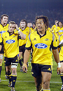 16 May, 2003. Jade Stadium, Christchurch, New Zealand. Super 12 Rugby Union, Semi Final, Crusaders v Hurricanes.<br />Hurricane captain Tana Umaga leads his players from the field after losing the semi final.<br />The Crusaders defeated the Hurricanes 39-16.<br />Pic: Andrew Cornaga/Photosport