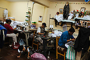 A group works inside a house of clothes dressmaking. The economic activity is informal mainly and people work behind closed doors to avoid taxes payment due to the large-scale production in Ciudad Nezahualcoyotl, March 17, 2009.