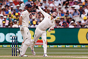 Nathan Lyon bowls a ball which gets a wicket during day three of the Australia v England fourth test at the Melbourne Cricket Ground, Melbourne, Australia on 28 December 2017. Photo by Mark  Witte.
