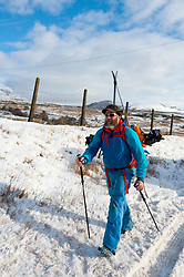 © Licensed to London News Pictures. 23/01/2019. Snowdonia, Conwy, Wales, UK. Cornish man Chris Hopwood from Capel Curig in Conwy and now working for Cotswold Outdoor, sets  off with ski-touring gear. Starting from the A5 road a few miles West of Capel Curig, in Snowdonia, Chris plans to cross the Carneddau range and arrive at Conwy town on the North coast of Wales. credit: Graham M. Lawrence/LNP