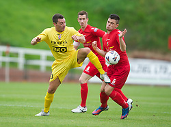 LLANELLI, WALES - Saturday, September 15, 2012: Llanelli's Ashley Evans in action against Newtown's Nicky Ward during the Welsh Premier League match at Stebonheath Park. (Pic by David Rawcliffe/Propaganda)