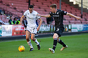 2nd Aug 2019, East End Park, Dunfermline, Fife, Scotland, Scottish Championship football, Dunfermline Athletic versus Dundee;  Cammy Kerr of Dundee runs at Lewis Martin of Dunfermline Athletic