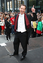 © Licensed to London News Pictures. 11/10/2015. London, UK. Strictly Come Dancing's assistant Charleston choreographer Scott Cupit strikes a pose as volunteers rehearse an attempt to break the world record for the largest number of people dancing the Charleston at Spitalfields. Photo credit: Peter Macdiarmid/LNP