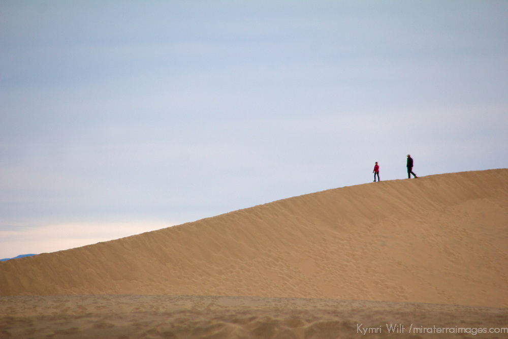 USA, California, Death Valley. Two people at Mesquite Flat Dunes.