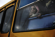 After leaving Libya,  Egyptian migrant workers stormed a bus at the transit camp in Choucha, 7 km from Tunisia's Ras Jedir border station. They will be driven to Djerba airport for return flights to Egypt. 28 February 2011.