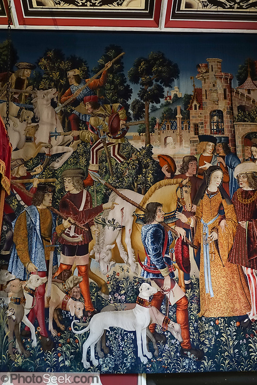 """Hunt of the Unicorn"" replica tapestries in the Scottish Queen's Inner Hall in the Royal Palace at Stirling Castle, in Scotland, United Kingdom, Europe. The Royal Palace was childhood home of Mary Queen of Scots. The palace's lavish design drew on European Renaissance fashions to show off James V's power and good taste. Historic Scotland has recreated the palace interiors as they may have looked when the Scottish king's grand scheme was complete. The ""Hunt of the Unicorn"" tapestries in the Queen's Lodgings are replicas hand-loomed from 2001-2014, inspired from the seven original tapestries made in Brussels between 1495-1505 (now in the Cloisters museum of New York's Metropolitan Museum of Art). Why a unicorn? In Celtic mythology the unicorn symbolized purity, innocence, masculinity and power. The proud, haughty unicorn was chosen as Scotland's national animal because it would rather die than be captured, just as Scots would fight to remain sovereign and unconquered. Once the capital of Scotland, Stirling is visually dominated by Stirling Castle. Most of Stirling Castle's main buildings date from the 1400s and 1500s, when it peaked in importance."