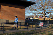 A voter leaves the Sycamore Recreation Center in Fort Worth, Texas on March 4, 2014. (Cooper Neill / for The Texas Tribune)