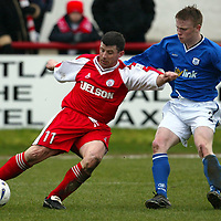 Brechin v St Johnstone...27.03.04<br />Ally Mitchell holds off Mark Baxter<br /><br />Picture by Graeme Hart.<br />Copyright Perthshire Picture Agency<br />Tel: 01738 623350  Mobile: 07990 594431
