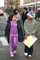 Mothers and daughters walking to school,