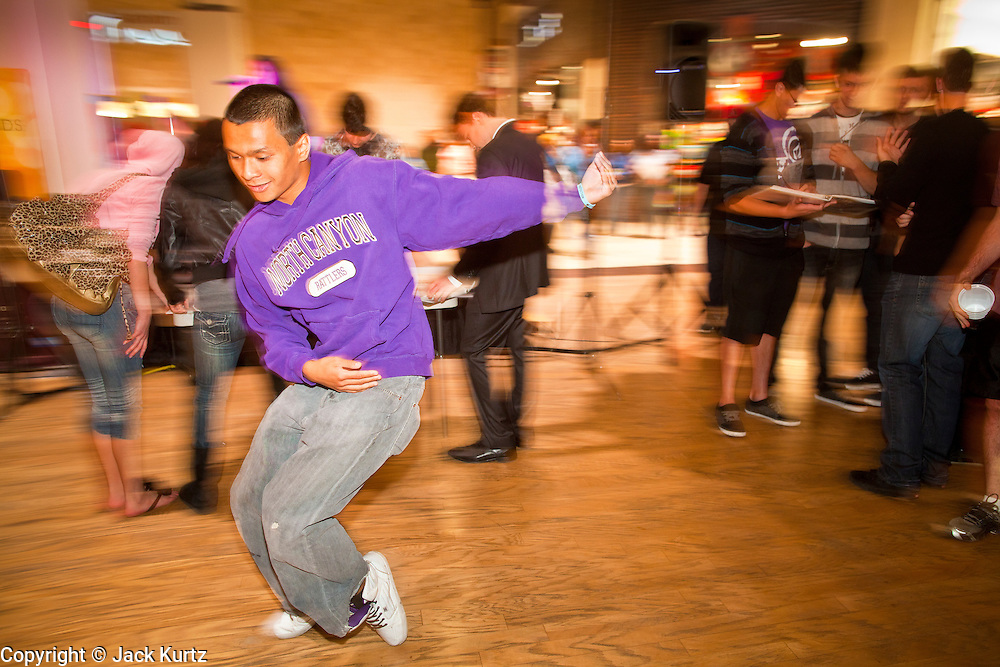 "25 NOVEMBER 2011 - PHOENIX, AZ:   Kyle Dela Rose (CQ), a member of the wrestling team at North Canyon High School, break dances in the center courtyard at Paradise Valley Mall Friday morning. ""Black Friday,"" the unofficial start of the holiday shopping season started even earlier than normal. Many stores, including Target and Best Buy, opened at midnight.    Photo by Jack Kurtz"