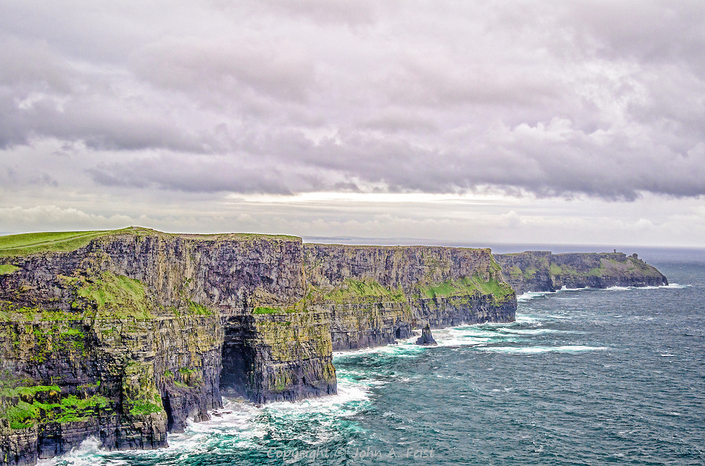 While not the tallest cliffs in Ireland, the Cliffs of Moher in County Clare are truly magnificent.  We visited them on a serious bad weather day.  You can see how rough the seas are at the base.  While we were visiting, we got hit by lots of rain and very strong winds.  The clouds here give you an idea of conditions that day.
