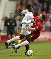 Photo. Aidan Ellis.Digitalsport<br /> Middlesbrough v Bolton Wanderers.<br /> FA Barclaycard Premiership.<br /> 03/04/2004.<br /> Bolton's Ricardo Vaz Te is tackled by Boro's Johnathon Greening