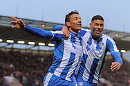 Macauley Bonne (left) celebrates scoring his sides first goal to make the scoreline 1-0 with Matthew Briggs during the Sky Bet League 1 match between Colchester United and Coventry City at the Weston Homes Community Stadium, Colchester<br /> Picture by Richard Blaxall/Focus Images Ltd +44 7853 364624<br /> 14/11/2015