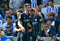 BRIGHTON, ENGLAND - MAY 12:     Aymeric Laporte (14) of Manchester City celebrates scoring a goal to make the score 1-2 and kisses the head of Riyad Mahrez (26) of Manchester City during the Premier League match between Brighton & Hove Albion and Manchester City at American Express Community Stadium on May 12, 2019 in Brighton, United Kingdom. (MB Media)