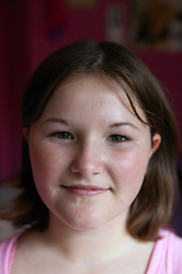 Portrait of a young girl smiling; part of the Independent Visitors Scheme,